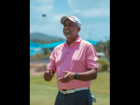 Sean Morris celebrates topping the JGA Heroes Weekend Golf Classic on Saturday at the Caymanas Golf Club. He defeated Mark Newnham by just one stroke at the end of the two-day tournament, which started at the Constant Spring Golf Club.