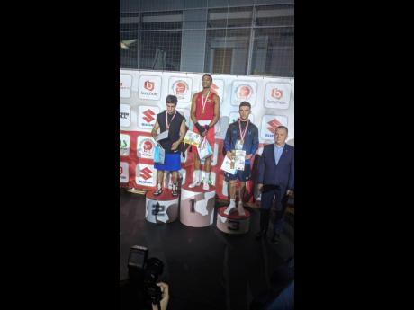Jamaica's Joshua Frazer (second left) stands atop the gold medal podium after beating Marat Gashimov (left) in the final of the Leszek Drogosz Memorial International Boxing Tournament in Kielce, Poland, yesterday.