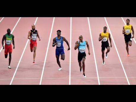 Steven Gardiner of The Bahamas (third right) strides to victory in the 400m at the IAAF World Championships in Doha, Qatar, on Friday, October 4, 2019. Others (from left) are Kirani James of Grenada, Machel Cedenio of Trinidad and Tobago, Fred Kerley of the United States, Demish Gaye of Jamaica, and Akeem Bloomfield, also of Jamaica. Gaye was fourth and his compatriot, Bloomfield, finished eighth.