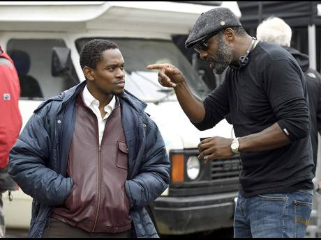 Idris Elba (right) directs actor Aml Ameen on the set of 'Yardie'.