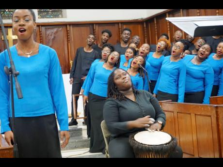 Soloist Dominique Campbell and percussionist Nora-Gaye Banton with other members of the University Chorale perform during 'Eclectic Roots Fall Chapel Concert at the University Chapel, Mona, last Sunday, November 3, 2019.