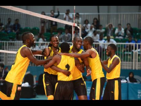 Members of the Special Olympics Jamaica volleyball team celebrate after defeating Japan two sets to one to capture the gold medal in the event at the Special Olympics World Summer Games in Abu Dhabi, United Arab Emirates, on Wednesday, March 20, 2019.
