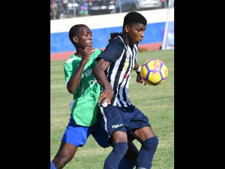 Jamaica College's Alvarez Cooper (right) shields the ball from Vauxhall High School's Sylvester Douglas during their ISSA/Digicel Manning Cup game at the Ashenheim Stadium on Friday, September 13, 2019.