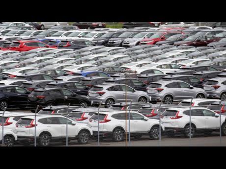 In this July 8, 2019 photo, Honda cars wait to be exported at Yokohama port, near Tokyo.