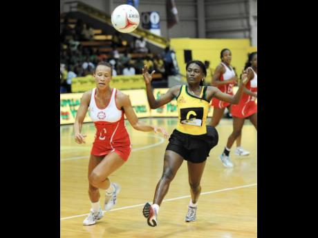 Jamaica's Khadijah Williams (right) runs ahead of England's Serena Guthrie in their final game of their three-Test Supreme Ventures Sunshine Series at the National Indoor Sports Centre in 2013. England won 50-36