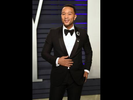 This February 24 file photo shows John Legend at the Vanity Fair Oscar Party in Beverly Hills, California. People magazine has named Legend as the 'Sexiest Man Alive' in their special November double issue.