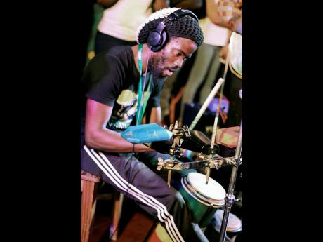 Percussionist Hector Lewis shows his versatility on the multi-percussion rack and hand drums.