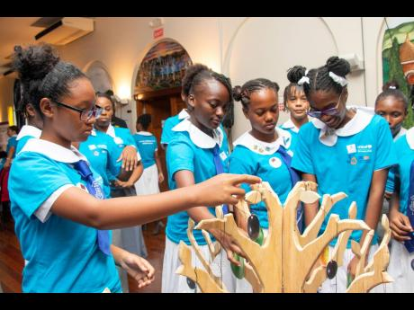 Children put their recommendations for actions to address violence against children on a vision tree, during a September 26 town hall event in Montego Bay, St James. organised by UNICEF in collaboration with the Office of the Children's Advocate and Talk Up Yout.