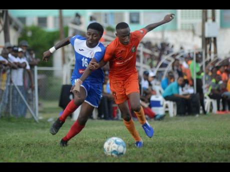 Tivoli Gardens' Trayvon Reid (right) challenges Roberto Johnson of Portmore United in a chase for the ball during their Red Stripe Premier League match at the Edward Seaga Complex on Sunday afternoon.
