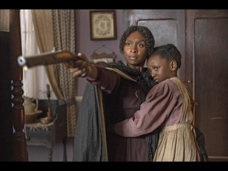 Cynthia Erivo as Harriet Tubman and Aria Brooks as Anger at age eight in 'Harriet'.