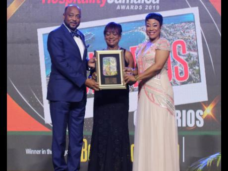 Mayor of St Ann's Bay Michael Belnavis and Vana Taylor (centre), president of the St Ann Chamber of Commerce, accept the Best Resort Town award from Copa Airlines' Nicole Cunningham.