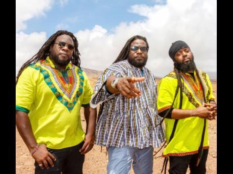 Mr. Mojo, Gramps and Peetah Morgan representing for Africa and Jamaica