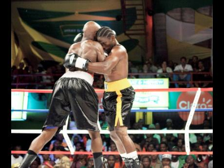 Kevin 'Bus Boy' Hylton (right) up against Ian 'Hagler' Smith in a Wray and Nephew Contender match at the Chinese Benevolent Association Auditorium in St Andrew on Wednesday, May 2, 2012.