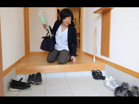 Programme coordinator Mayuko Fukasawa explains that shoes, though worn to the office, are never allowed into Japanese homes beyond the genkan, a specially designated holding area inside the doorway.