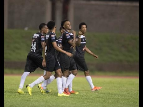 Cavalier FC players celebrate a goal scored by Alex Marshall (second right) during a Red Stripe Premier League game on Sunday, September 15, 2019.