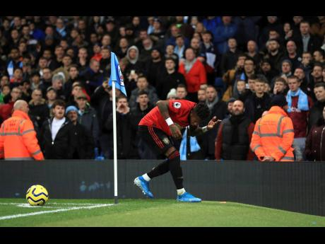 Manchester United's Fred reacts after objects are thrown at him during the English Premier League match at the Etihad Stadium, Manchester, England, yesterday.