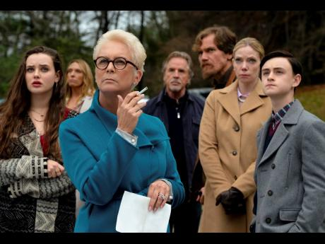 Katherine Langford, from left, Toni Collette, Jamie Lee Curtis, Don Johnson, Michael Shannon, Riki Lindholm and Jaeden Lieberher in a scene from 'Knives Out.'