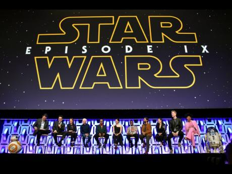 ABOVE: In this April 12, 2019, photo, Stephen Colbert, (from left) , J.J. Abrams, Kathleen Kennedy, Anthony Daniels, Billy Dee Williams, Daisy Ridley, John Boyega, Oscar Isaac, Kelly Marie Tran, Joonas Suotamo and Naomi Ackie participate in the 'Star Wars: The Rise of Skywalker' panel on day 1 of the Star Wars Celebration at Wintrust Arena in Chicago.