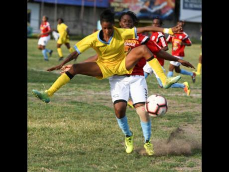 Waterhouse's Jessica Johnson (front) leaps to avoid a challenge from Olympic Gardens defender Stephanie Morgan in their JFF Womens' Premier League fixture at the Drewsland Stadium on Saturday, August 24, 2019.