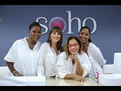 Michele Coulton (second right), managing director of SoHo Boutique, is joining forces with her staff to stage the Christmas Closet charity drive. From left are sales associates Dionne Sadler and Crystal Porter-Jackson, and Manager Karen Sankar.