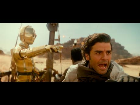 C-3PO, portrayed by Anthony Daniels (left), and Oscar Isaac as Poe Dameron seen in action in the movie 'Star Wars: The Rise of Skywalker.'