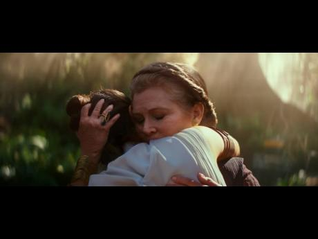 The late Carrie Fisher (right) as General Leia Organa, and Daisy Ridley as Rey in a scene from 'Star Wars: The Rise of Skywalker'.