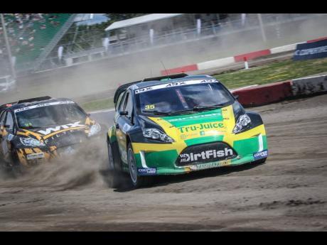 Jamaican driver Fraser McConnell takes his black, green, and gold race car around the track during action at the Canadian leg of the ARX2 Championship earlier this year.