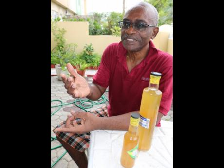 Businessman Clyde Johnson speaks about the hardships he has had in collecting payment for his moringa wine, which has found favour with locals and foreigners alike.