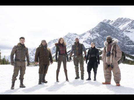 From left: Nick Jonas, Jack Black, Karen Gillan, Dwayne Johnson, Awkwafina and Kevin Hart star in 'Jumanji: The Next Level'.