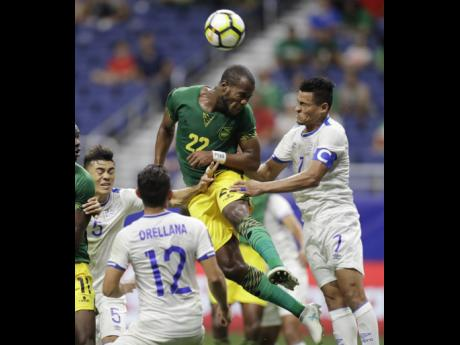 Jamaica's Romario Williams (centre) tries to put a header on goal  against El Salvador during a CONCACAF Gold Cup match in San Antonio in July 2017. The game ended 1-1.