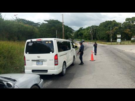 Motorists slow to a halt as police man a checkpoint in Westmoreland.