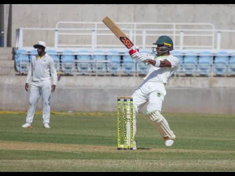 Windward Islands Volcanoes batsman Kavem Hodge plays a pull shot on his way to a half-century on the opening day of their Cricket West Indies Professional Cricket League 4-Day Championship match against Jamaica Scorpions at Sabina Park yesterday.