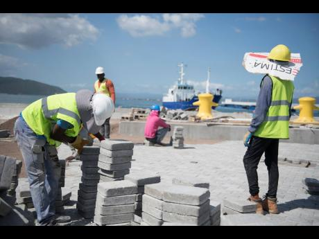 Labourers are seen at the Old Coal Wharf worksite that houses the Port Royal pier on Friday ahead of the arrival of the Marella Discover 2 cruise ship scheduled to visit the town on Monday, January 20.