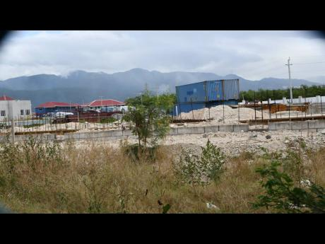 The $701-million, three-storey building under construction at the Caribbean Maritime University's east Kingston campus, which was scheduled to be completed this month, is months off schedule.