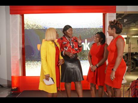 Budding entrepreneur, Sophia Bryan (second left) captures the attention of (from left) Cortia Bingham, We Inspire Women co-founder and CEO, Venisa Linton of Hillel Academy, and Shani Duncan-Falcolner, JMMB's corporate manager, SME Resource Centre at the recent small and medium-size enterprise seminar. The event took place at the  ATL Showroom in Montego Bay, and  is the second staging of this event.