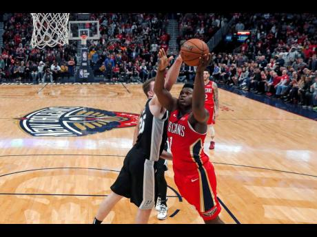 New Orleans Pelicans forward Zion Williamson (right) goes to the basket against San Antonio Spurs centre Jakob Poeltl in the second half of their NBA game in New Orleans, Louisiana, on Wednesday.