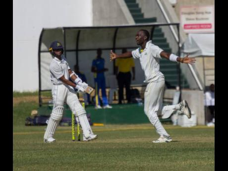 Jamaica Scorpions fast bowler Marquino Mindley (right) celebrates after picking up the wicket of Barbados Pride wicketkeeper-batsman Shane Dowrich during their Cricket West Indies Professional Cricket League Regional 4-Day Championship match at Sabina Park yesterday.