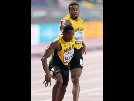 Akeem Bloomfield (right) hands off the baton to Nathon Allen in the men's 4x400m semi-final at last year's World Athletics Championships in Doha, Qatar.