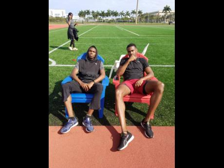Two of the country's top 400m runners, Nathon Allen (left) and Akeem Bloomfield, relaxing after a hard training session at Florida Atlantic University recently.