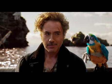 Dr John Dolittle (Robert Downey Jr) and parrot Polynesia (Emma Thompson) in 'Dolittle', directed by Stephen Gaghan.