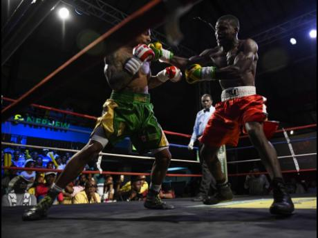 Jamaica's Nico Yeyo faces off against Canada's Mayron Zefferino during a Wray & Nephew Contender Series match at the Chinese Benevolent Association Auditorium on Wednesday, April 11, 2018.