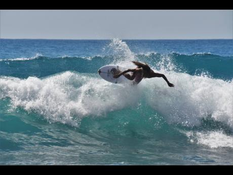 Shama Beckford competing at the Jamaica Surfing Association National Open Series at the Copacabana Beach in Bull Bay, St Andrew, on Sunday.
