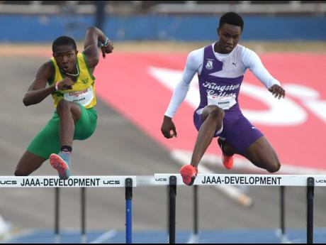 Excelsior High School's Devontie Archer (left) keeps pace with Kingston College's Santhamoi Brown in the boys' 15-16 hurdles at the G.C. Foster Classics at the National Stadium on Saturday, March 11, 2018.