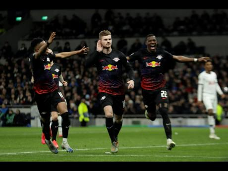 Leipzig's Timo Werner (center) celebrates after scoring his side's goal during a first leg, round of 16, UEFA Champions League match against Tottenham Hotspur at the Tottenham Hotspur Stadium in London, England yesterday.