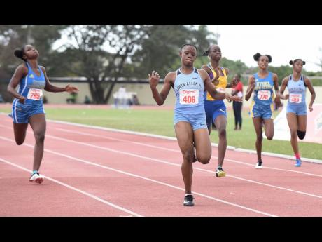 Tina Clayton (second left) of Edwin Allen High wins the Class Two Girls 200m final in 23.57 seconds ahead of Hydel High's Shenese Walker (left), Dejanea Oakley (centre) of Clarendon College, Hydel's Machaeda Linton (second right), and Edwin Allen's Shenequa Vassell at the Digicel Central Championships at the G.C. Foster College in Spanish Town, St Catherine, last Wednesday.