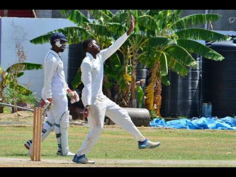 St George's College Under-19 cricket team captain Nicholas Lewin bowls a delivery during their ISSA Grace Shield match against rivals and hosts Kingston College on Thursday.