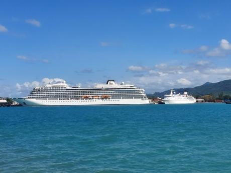 A ship and yacht are seen off the coast of Montego Bay yesterday. Jamaicans have expressed mixed feelings over the Jamaican Government's coronavirus protocols.
