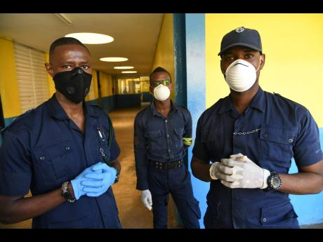 Members of the Department of Correctional Services wearing face masks during a tour of the Horizon Adult Remand Centre in Kingston on Friday.