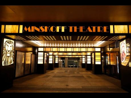The Minskoff Theatre is shuttered Thursday, March 12, in New York, near Times Square, after Broadway theatres closed following New York Governor Andrew Cuomo's banning of gatherings of more than 500 people over concerns about the spread of the coronavirus.