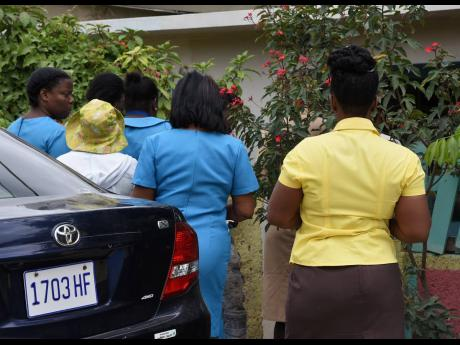 Healthcare workers were conducting temperature checks on residents of Pondside in St Thomas on Thursday, as Jamaica seeks to contain a COVID-19 outbreak.